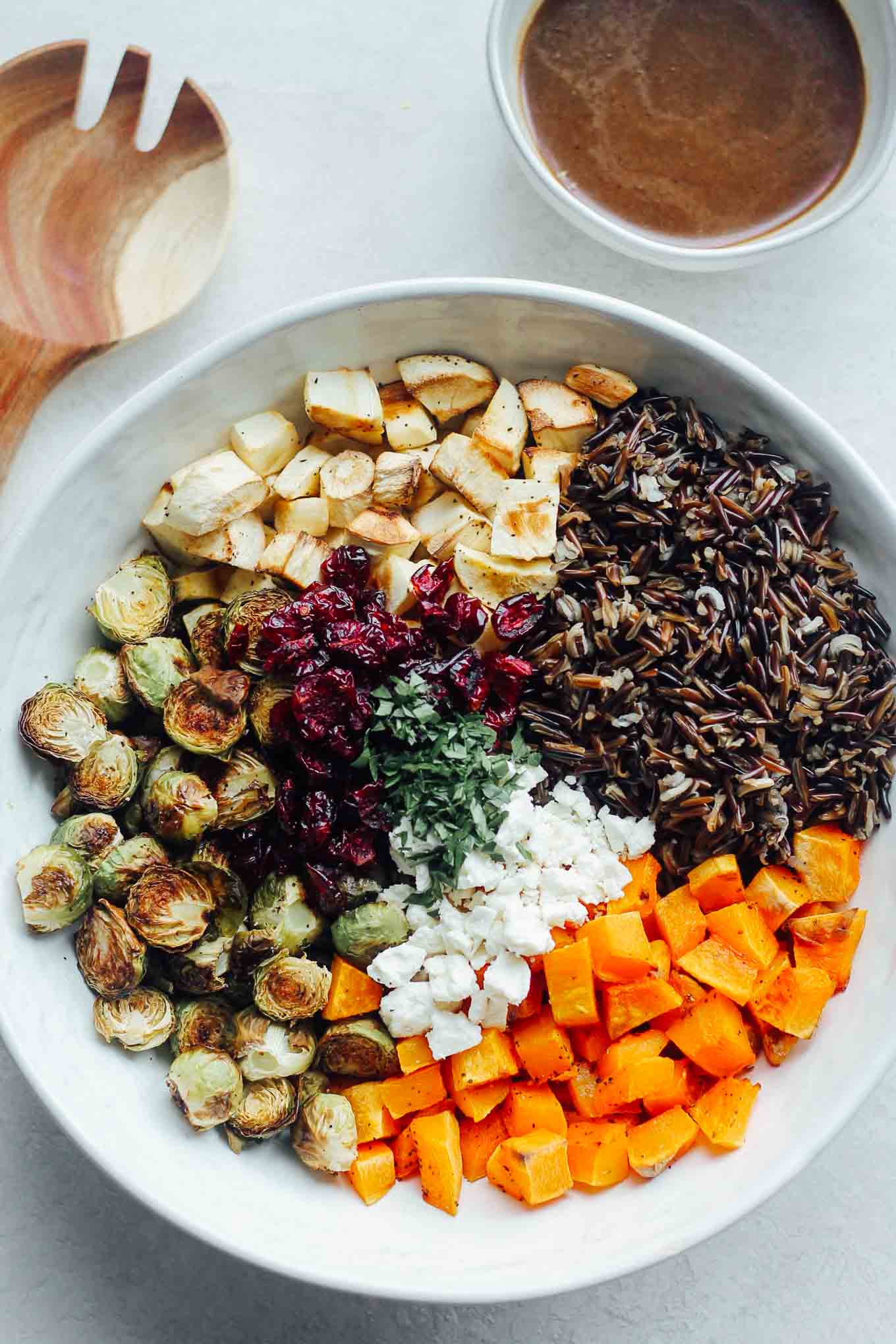 An overhead view of each ingredient in the bowl before tossing with dressing