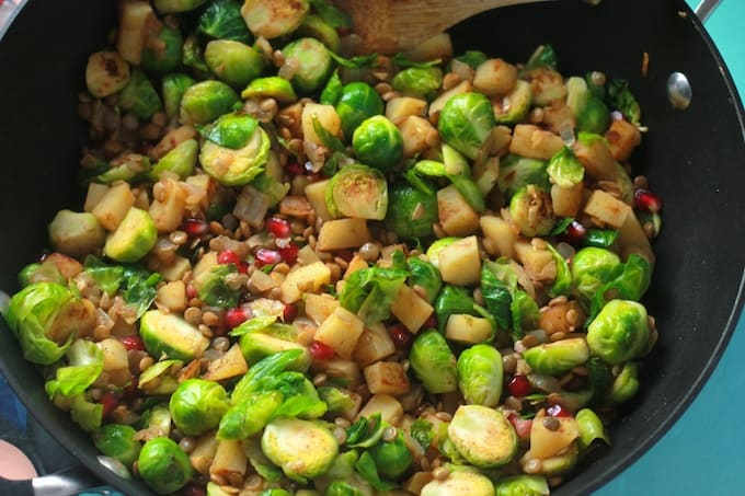 Brussels Sprout, Sweet Potato, and Lentil Saute | Destination Delish - a sweet and savory blend of veggies sautéed with warm spices and topped with juicy pomegranate arils