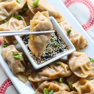 Kimchi Pineapple Dumplings | Destination Delish - A unique take on the traditional Chinese dumpling. This sweet and spicy appetizer is filled with ground turkey, pineapple, and kimchi
