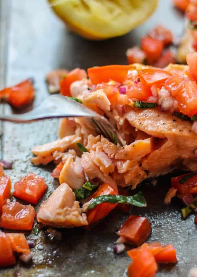 Roasted Salmon with Tomato Basil Relish | Destination Delish – a quick and easy recipe for roasted salmon topped with a vibrant, tangy, and fresh Italian-inspired relish.