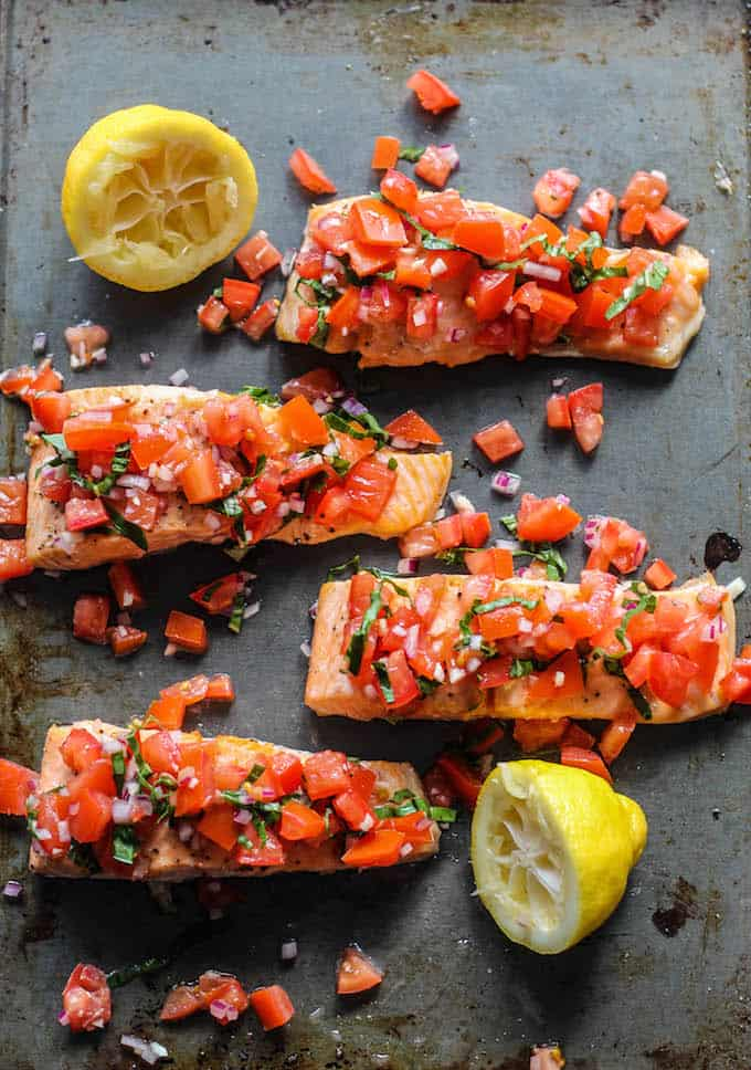 Roasted Salmon with Tomato Basil Relish | Destination Delish – a quick and easy recipe for roasted salmon topped with a vibrant, tangy, and fresh Italian-inspired relish