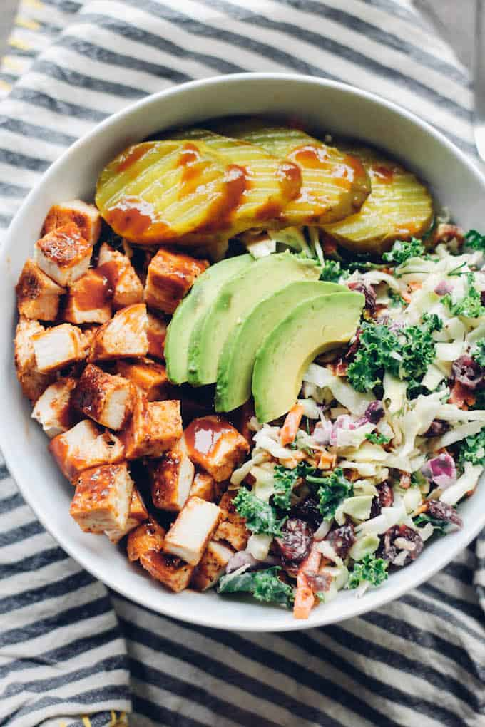 BBQ Chicken Coleslaw Bowls | Destination Delish – a healthy bowl full of tender chicken and coleslaw topped with pickles and creamy avocado slices! It's everything you love about summer barbecues in a bowl!