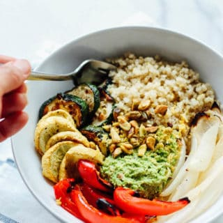 Quinoa Bowls with Pea Pesto | Destination Delish – wholesome vegetarian bowls full of quinoa and roasted veggies topped with a zesty and sweet pea pesto