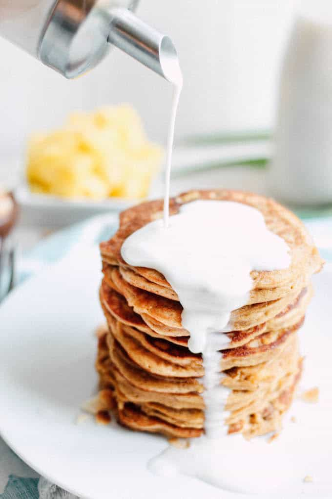 Piña Colada Pancakes | Destination Delish - Paleo pancakes with a tropical flair, using wholesome ingredients like coconut flour, nut butter, and fresh pineapple.