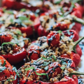 Quinoa Caprese Stuffed Peppers | Destination Delish – The classic caprese cooked inside a bell pepper! It's a light and fresh summer side dish easy enough for weeknights and fancy enough for guests!