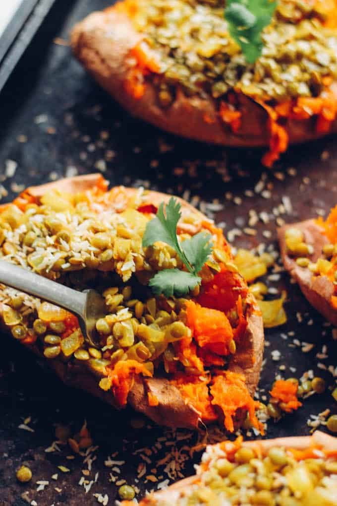 Curry Lentil Stuffed Sweet Potatoes | Destination Delish - Tangy, curry lentils tucked inside a tender sweet potato. It's a healthy side or main dish that's easy to prepare and full of flavor! Vegetarian. Vegan. Gluten free.
