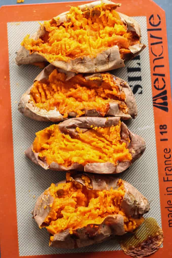 Curry Lentil Stuffed Sweet Potatoes | Destination Delish - Tangy, curry lentils tucked inside a tender sweet potato. It's a healthy side or main dish that's easy to prepare and full of flavor! Vegetarian. Vegan.