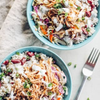 Jerk Pork Coleslaw Bowls | Destination Delish - Spice up your dinner routine with the flavors of Jamaica. Tender, pulled pork marinated in a spicy jerk sauce served on a bed of crisp and tangy coleslaw!