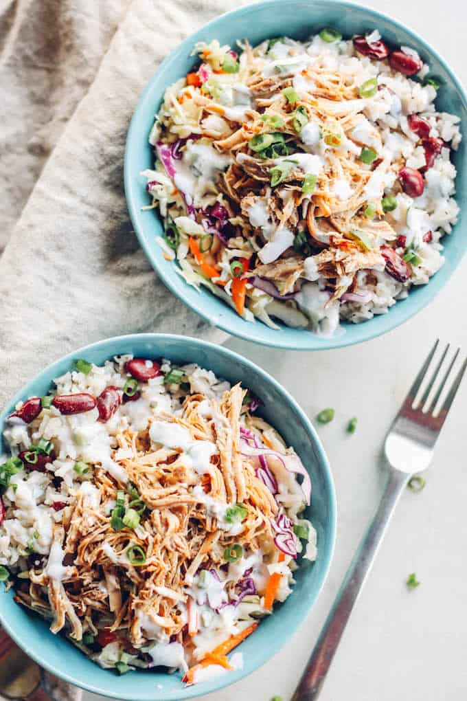 Jerk Pork Coleslaw Bowls | Destination Delish - Spice up your dinner routine with the flavors of Jamaica. Tender, pulled pork marinated in a spicy jerk sauce with coconut-infused rice and crisp and tangy coleslaw!
