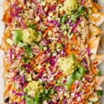 Asian Chicken Wonton Nachos spread out on a sheet pan